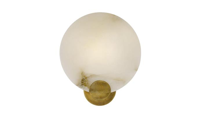 """Iveala single sconce in Antique Brass and Alabaster, $1089, at [The Montauk Lighting Co.](https://www.montauklightingco.com/products/iveala-single-sconce