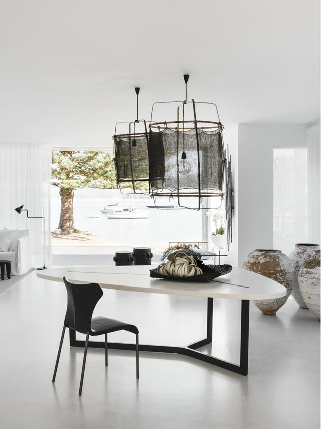 "After meeting with the owner, Pamela Makin of Les Interieurs decided to [design the colour palette around the beach and ocean](https://www.homestolove.com.au/beachside-home-in-sydney-inspired-by-its-location-20012|target=""_blank""), referencing the home's pastel marine linens, textured sisal rugs, pale sheer curtains, white cotton-slip sofas and net-like pendants. Hanging in the living room is a pair of 'Z11' cashmere pendant lights by Ay Illuminate. *Photograph*: Felix Forest. From *Belle* May 2019."