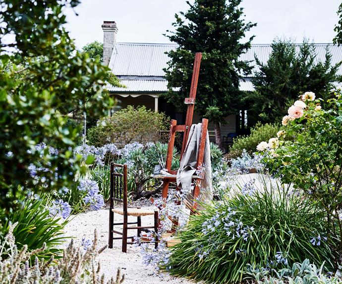 Painting easel set up in a cottage garden