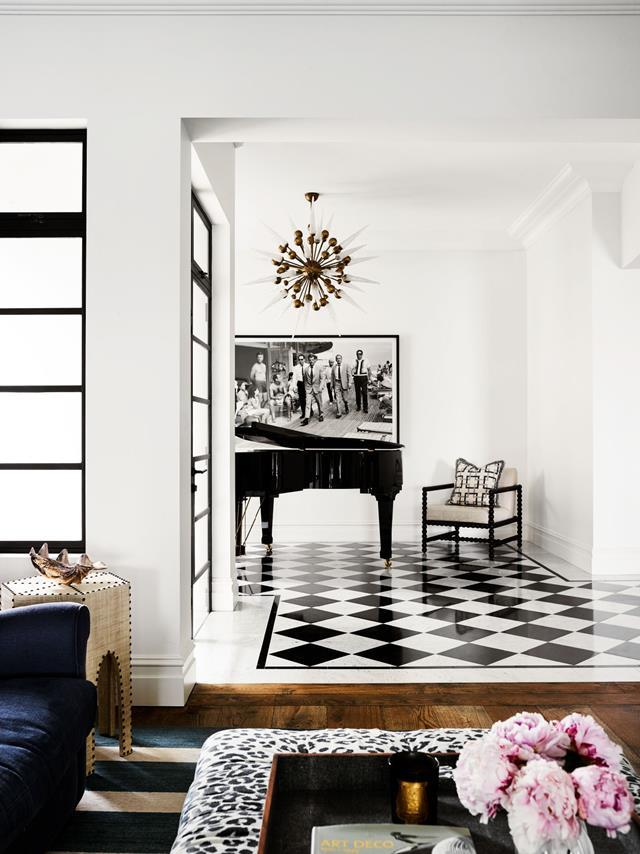 "The owner's former childhood home has been reinvented for her own family in a style marrying [Spanish Mission and Hollywood Regency](https://www.homestolove.com.au/a-spanish-mission-style-homes-hollywood-glamour-update-6677|target=""_blank""). The piano room has a vintage chandelier from Conley & Co. *Photograph*: Anson Smart 