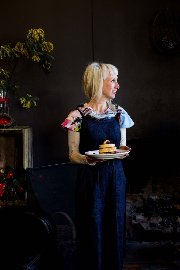 Laura Fraumeni, owner of Nest, with a plate of fluffy pancakes, served with local berries.