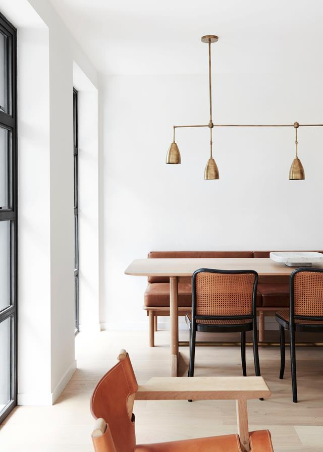"This majestic [19th-century inner-city terrace](https://www.homestolove.com.au/a-revamped-sydney-terrace-with-a-tranquil-aesthetic-19031|target=""_blank"") has been lovingly restored by Megan Burns of CM Studio. 'Twig 5' pendant from Apparatus Studio hangs over the dining table and banquette designed and built by Jonathan West. *Photograph*: Prue Ruscoe 