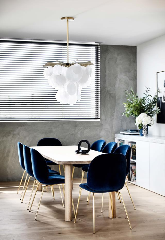 "This penthouse was a [four-year project](https://www.homestolove.com.au/a-sophisticated-entertainers-penthouse-in-brighton-18857|target=""_blank"") by Vanda and Tom Robertson Architects. Bec van der Sluys called on Simone Haag to collaborate with her on styling the interiors. Large windows let in natural light and a dramatic glass chandelier adds dazzle. *Photograph*: Derek Swalwell. From *Belle* August/September 2018."