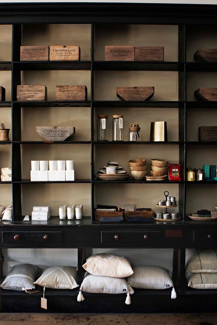 The shop's original shelving now holds products including old produce boxes, candles and soaps.