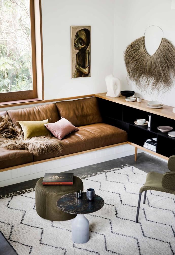 "**Media room** Mostly used to chill out at night, this den-like space by Fine Earth Joinery is layered with soft leather and other tactile materials. Sheepskin and velvet cushions from Montmartre Store. Chair, ottoman and side table, [Domo](https://www.domo.com.au/|target=""_blank""