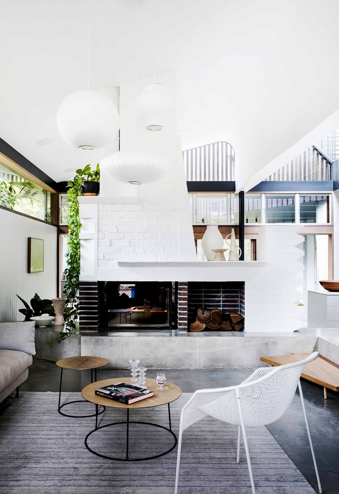 "**Living area** There's so much visual interest here, in the glass-panelled Cheminées Philippe fireplace, the offset and cut brickwork, the angled timber step and even the textured Heaven chair from [Ke-zu](https://www.kezu.com.au/|target=""_blank""