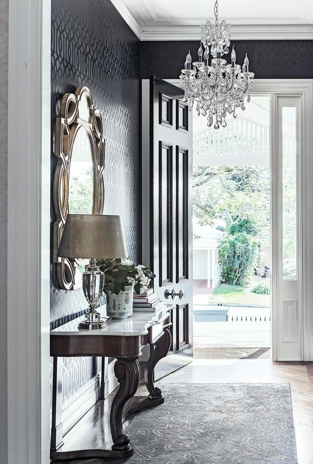 "[This beautiful home](https://www.homestolove.com.au/colonial-style-queenslander-home-5720|target=""_blank"") in Brisbane's inner-north has been with redesigned to accommodate the owner's love of entertaining and appreciation for high-end style. A vintage chandelier and imported gold mirror serve as jewellery for the glamorous foyer. *Photograph*: Maree Homer 