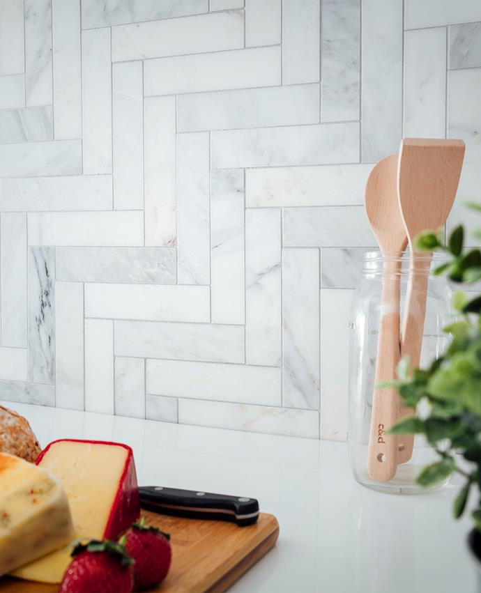 "Herringbone Calacutta Honed tiles, from [Beaumont Tiles](https://www.beaumont-tiles.com.au/product/tile/1000908|target=""_blank""