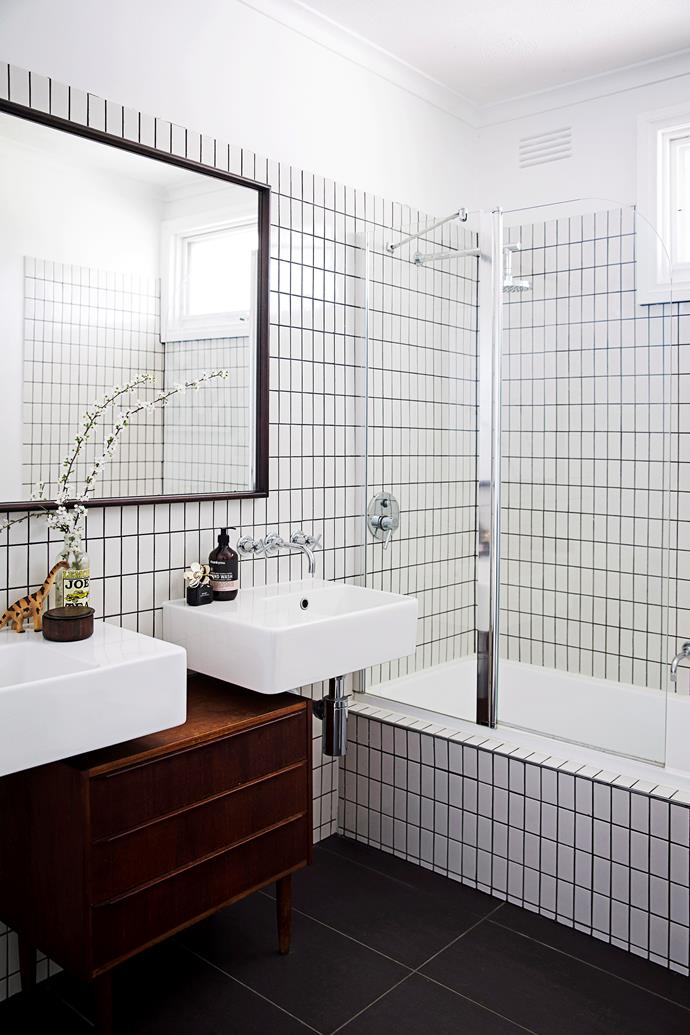 Slim subway tiles stacked vertically create the illusion of height in this bathroom. *Photo:* James Henry / *bauersyndication.com.au*
