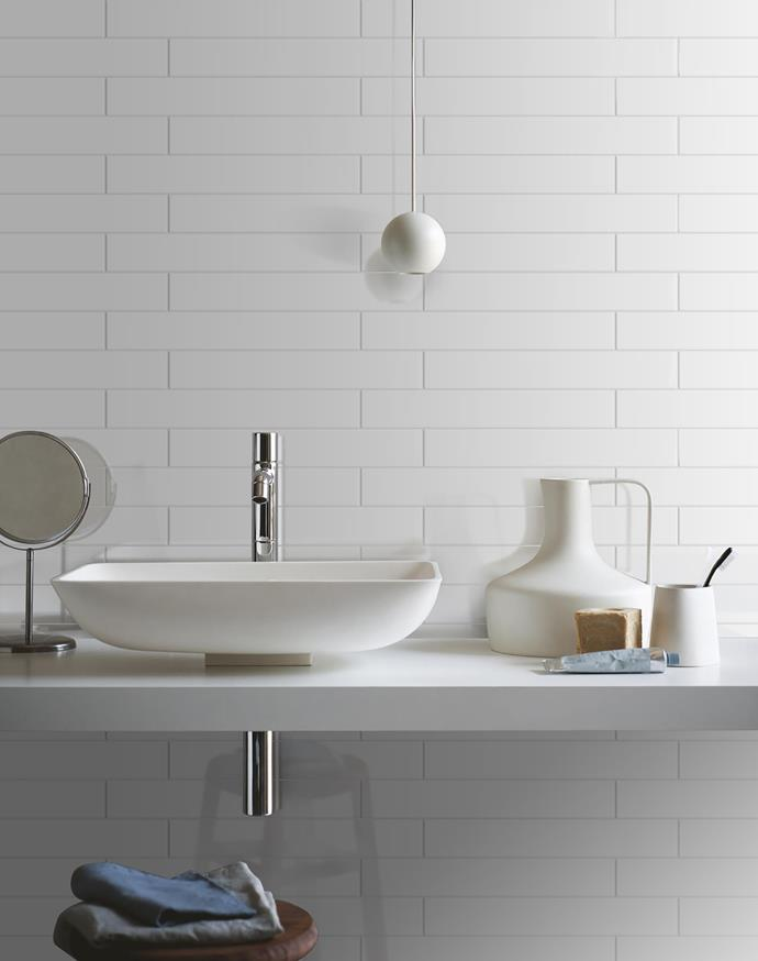 Longer and thinner than your standard subway tile, these 'Reunion White Gloss' tiles from Beaumont Tiles laid horizontally (a quarter offset) look elegant and timeless.