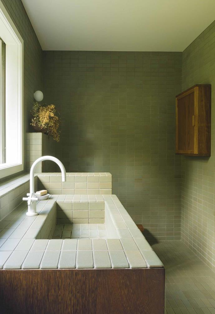 **Colour wash** <br><br>Both an homage and a modern makeover, this sanctuary-like bathroom by [Katie Lockhart Studio](https://katielockhart.com/) in New Zealand references the home's mid-century history while bringing it into the now with thoughtful design and bespoke details. <br><br>The [Heath Ceramics](https://www.heathceramics.com/) tiles, undoubtedly the room's hero, are beautifully complemented by the richly coloured Iroko timber joinery by designer Grant Bailey. <br><br>More contemporary touches are the Flos 'Mini Glo-Ball' wall light and matt white Dornbracht basin mixer. Green has never looked so good.<br><br>*Photography: Neeve Woodward*.