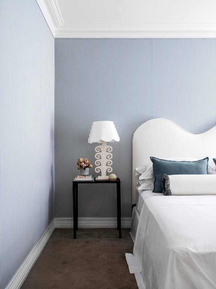 The guestroom has walls upholstered in a Schumacher fabric. Custom bedhead. Cushions in C&C Milano linen. Bedside lamp from The Vault Sydney.
