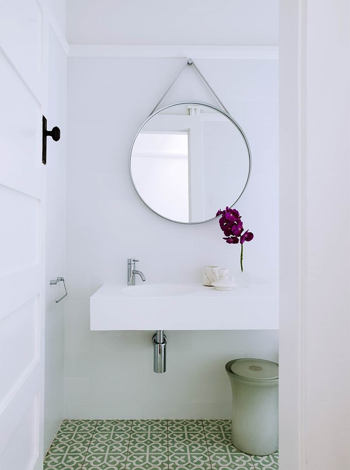 "Athena encaustic tiles from Teranova add pattern and colour to this [otherwise sparse bathroom](https://www.homestolove.com.au/modernism-inspires-laid-back-family-home-2762|target=""_blank""). Icon mixer from Astra Walker. Hay strap mirror from Cult. *Photograph* Prue Ruscoe 