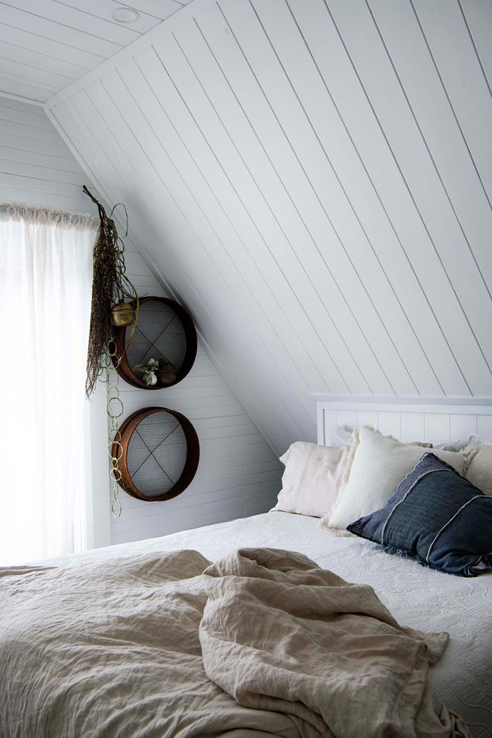 """Colin has built the bed, which is topped with cushions from Skylla and Cultiver and linen from The Summer People, both stores are located in [Milton, NSW](https://www.homestolove.com.au/milton-nsw-attractions-12581