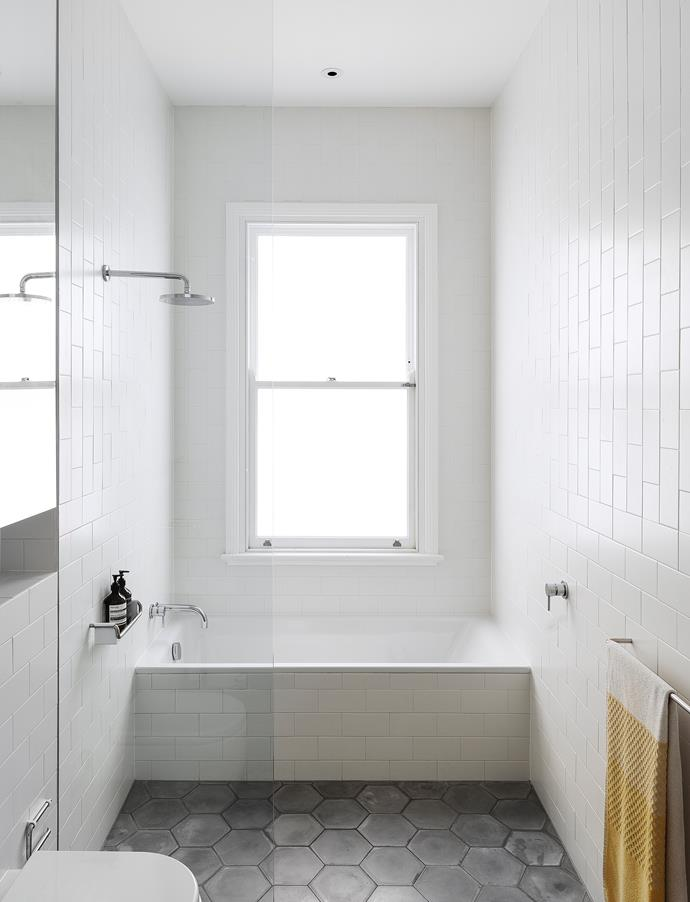 Opting for a walk-in shower saved precious floor space in this compact family bathroom designed by architect Eva-Marie Prineas.