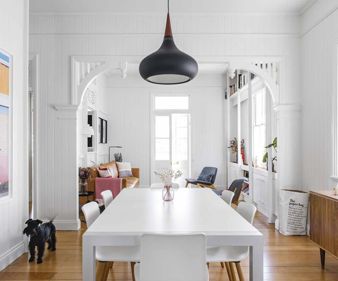 "**Dining area** ""Mike and Tom have lots of extended family and wanted everyone to feel comfortable when they come to stay,"" says interior designer Georgia Cannon. They paired the table, chairs and sideboard from their previous apartment with an imposing black Lightyears 'Orient' pendant from [Cult](https://cultdesign.com.au/