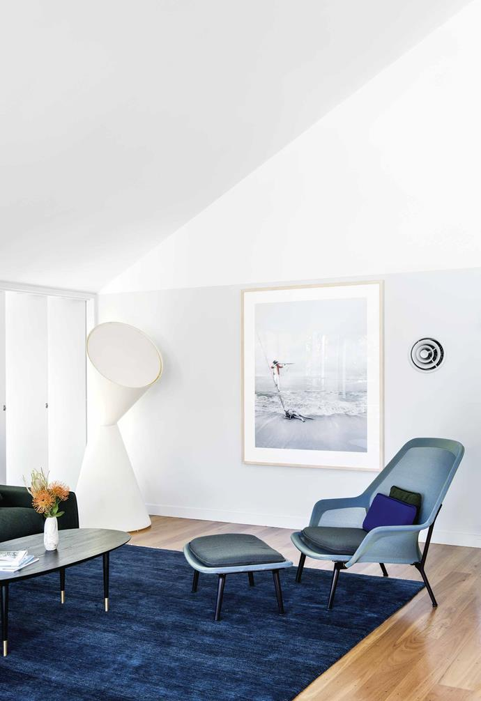 "**Living area** ""We wanted a mix of high-end pieces with more obtainable ones,"" says Georgia of the La La lamp by Helen Kontouris Design and Vitra 'Slow' chair and ottoman from [Living Edge](https://livingedge.com.au/
