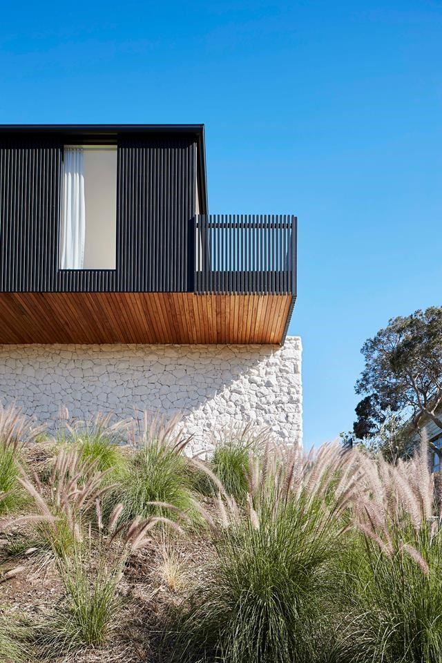 """This [home's coastal exterior](https://www.homestolove.com.au/sorrento-beach-house-19328 target=""""_blank"""") is clad in timber and stone courtesy of designer Sally Caroline. *Photograph*: Shannon McGrath. From *Belle* November 2018."""