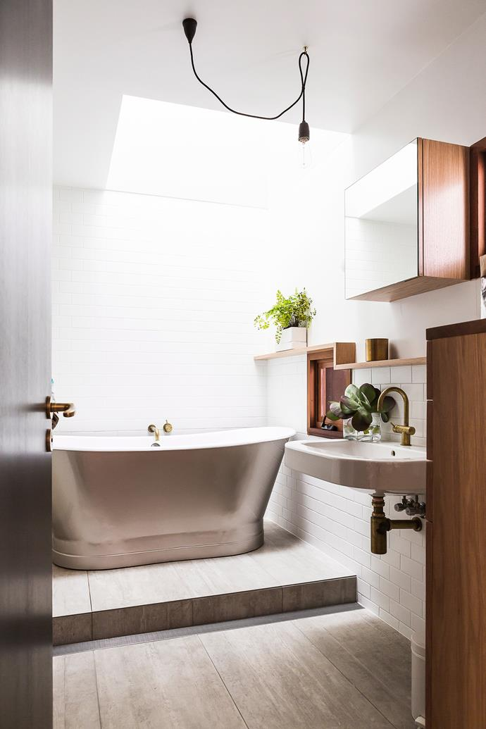 "If you've splashed out on a show-stopping [freestanding bathtub](https://www.homestolove.com.au/freestanding-baths-4520|target=""_blank""), make a star of it by placing it on a raised platform, and if space and budget permit, add a strategically placed skylight above for the ultimate illumination."
