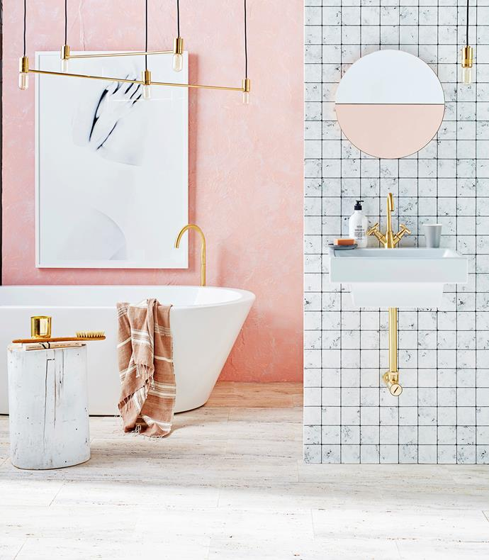 "Embrace the current fixation with [Millennial pink](https://www.homestolove.com.au/millennial-pink-bathrooms-18963|target=""_blank"") and up the sophistication stakes with ambient lighting, sleek gold tapware and a tiled feature wall. You can also get a similar look using waterproof, removable wallpaper."