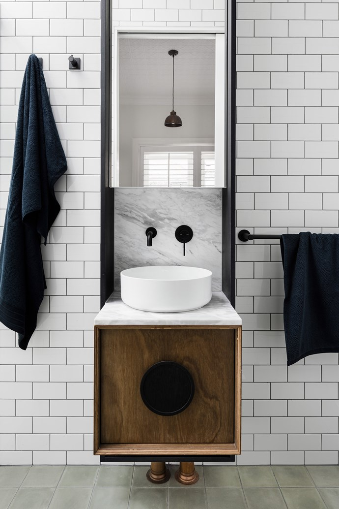 When space is limited, a slimline vanity adds a touch of hotel-style elegance to your ensuite without covering up those gorgeous wall and floor tiles. Mirrored cabinets provide storage and help the room seem larger. *Photo:* Armelle Habib / *bauersyndication.com.au*