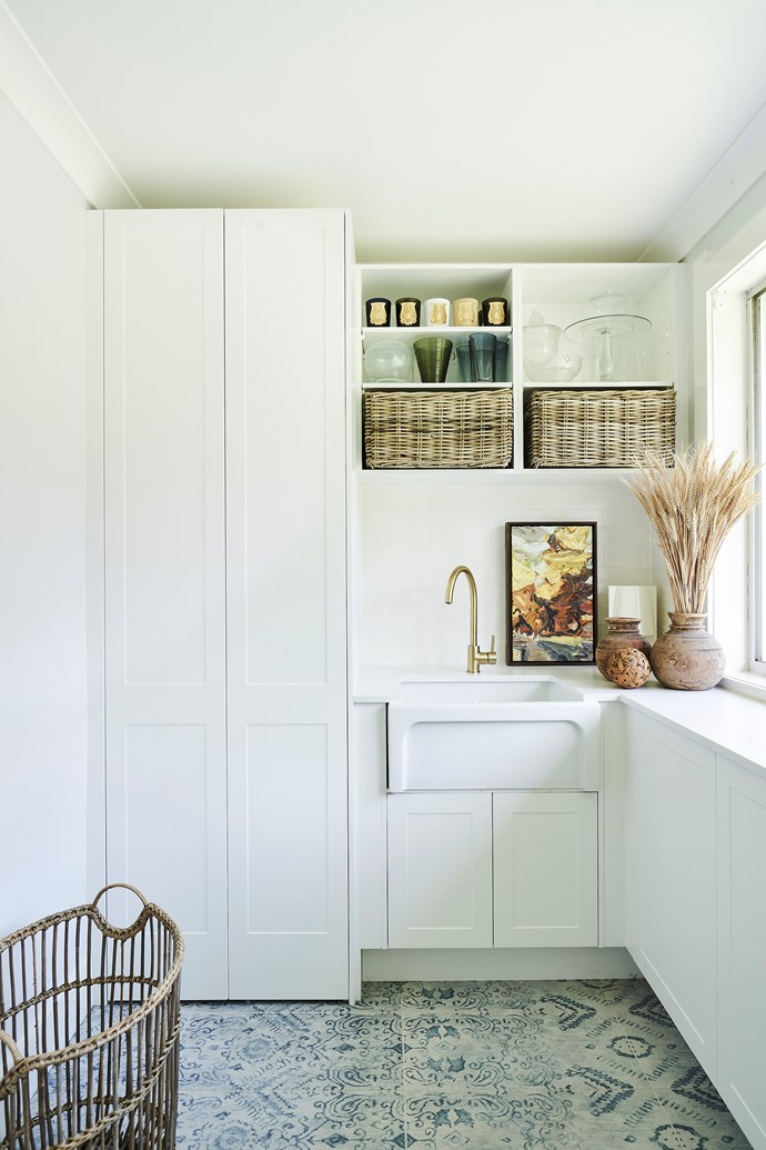 A mixture of open and closed shelving allows you to hide away dirty laundry and cleaning products while still adding a decorative touch. *Photo:* Kinsman