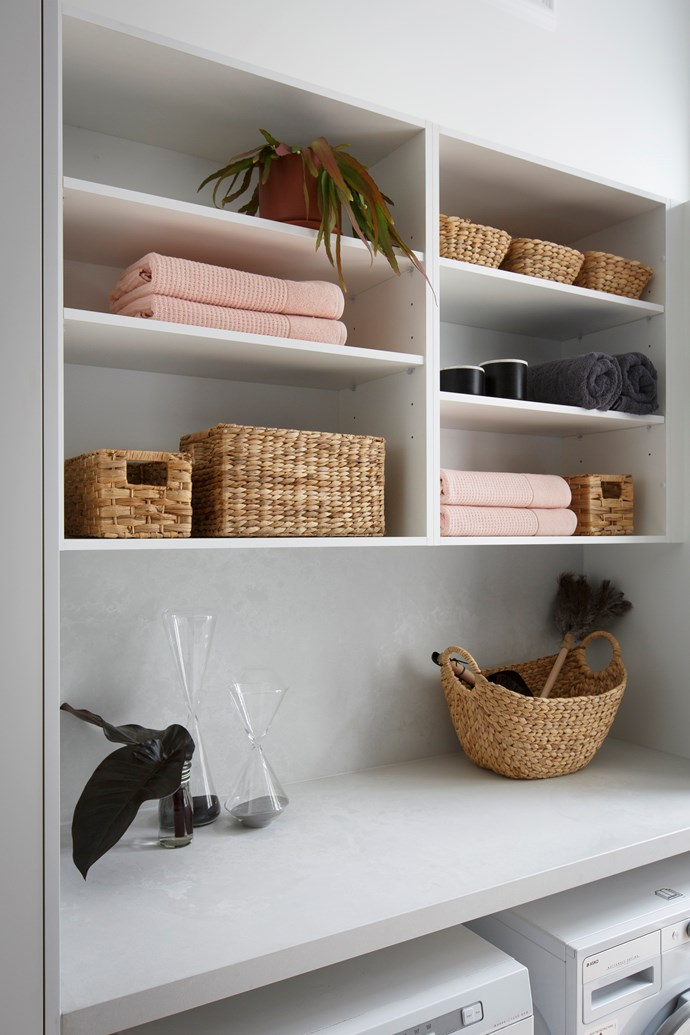 If you opt for open shelving, make sure you keep your display tidy and aesthetically pleasing with decorative storage containers and baskets. *Photo:* Kinsman