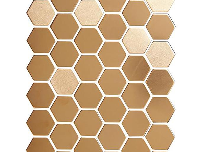 "Punched from a solid piece of high-quality copper, the show-stopping 'Honey' copper mosiac (29X25MM) hexagonal tiles from [Alloy](http://www.alloydesign.com.au|target=""_blank"") naturally oxidise over time to develop a subtle green-hued patina. Can be used on all interior and exterior walls and floors."