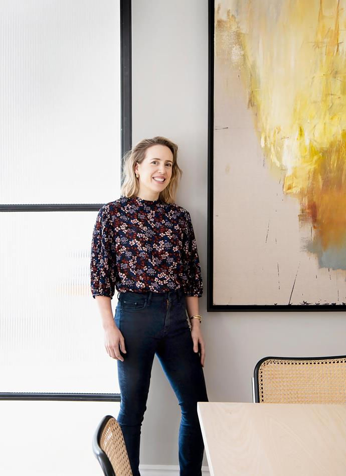 Homeowner Penelope Cohen stands beside a work by Jake Wood-Evans.