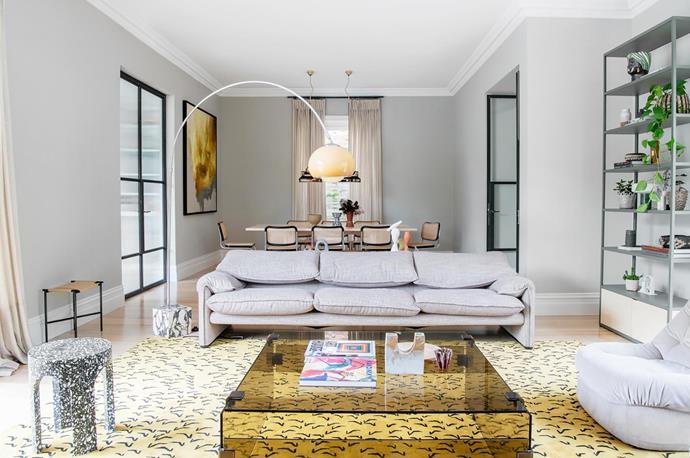Custom rug by Simone Haag. Cassina 'Maralunga' sofa from Space. Skagerak 'Vent' stool. Hay shelves styled by Simone Haag. Artwork by Jake Wood-Evans.