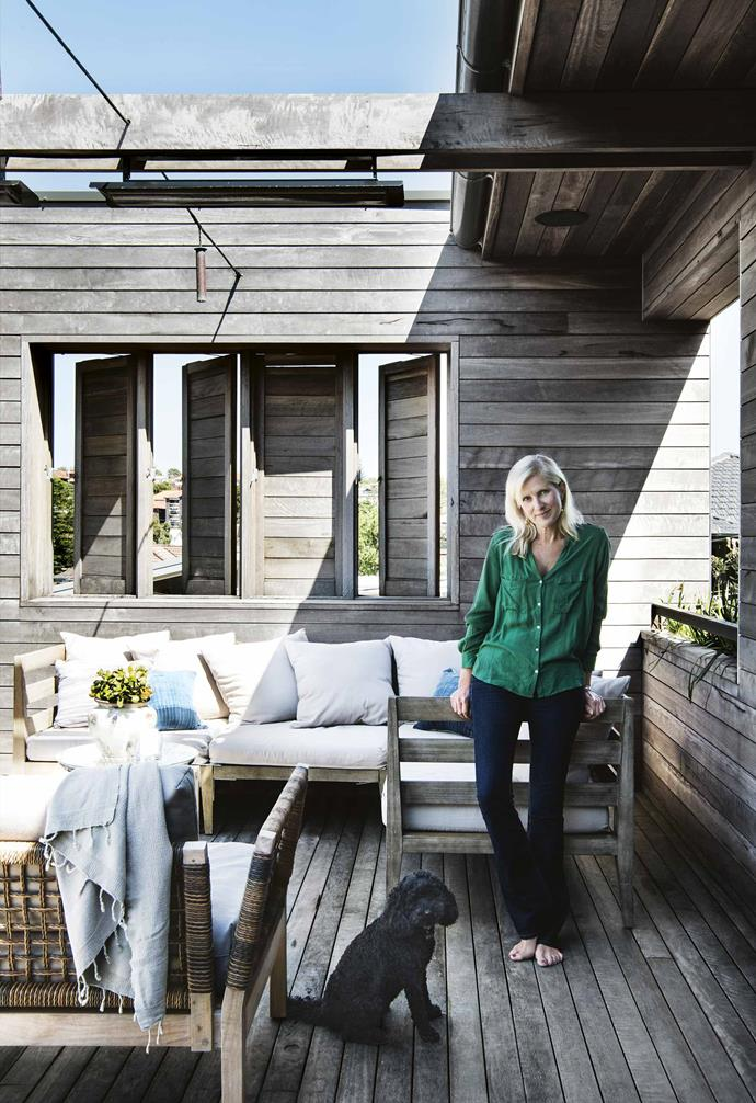 """Having knocked down the 1970s brick house that occupied the site, Kimberley and Ramon set about building their dream four-bedroom home over the course of a year. The couple brought in Melbourne firm [Farnan Findlay Architects](http://www.farnanfindlay.com.au/ target=""""_blank"""" rel=""""nofollow""""), who designed four floors to fit onto a relatively small footprint of 320 square metres, which makes the rooms feel cosier than your average contemporary building – a relief in a world of big white boxes.<br><br>**Deck** Owner Kimberley with Pepper the poodle. The spotted gum cladding brings a relaxed beach house feel while the woven back of an [Eco Outdoor](https://www.ecooutdoor.com.au/ target=""""_Blank"""" rel=""""nofollow"""") 'Hutt' sofa brings another texture into the mix. Turking towel, [Atolyia](https://www.atolyia.com/ target=""""_Blank"""" rel=""""nofollow"""")."""