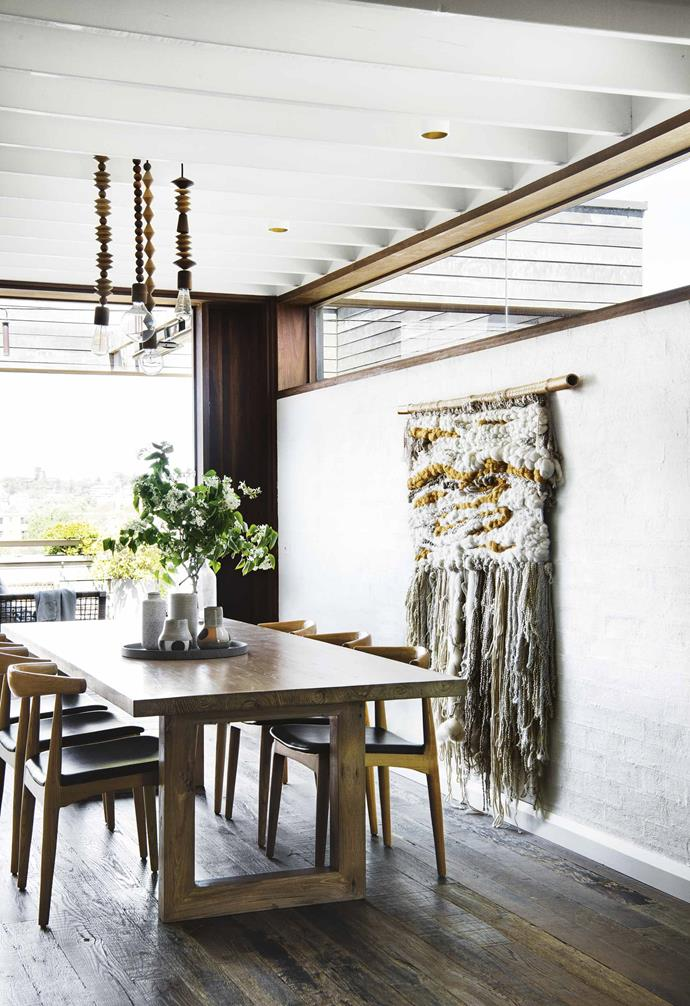 """And the bricks-inside-and-wood-outside trick is no mistake – it's actually highly functional for a [climate as changeable as Sydney](https://www.homestolove.com.au/home-building-tips-hot-climates-14914 target=""""_blank""""), and works in line with the couple's green goals for the house. """"The construction method is reverse brick veneer, which is taking the standard brick veneer construction and flipping it,"""" says architect Michelle Findlay, who designed the building with her partner Joel Farnan.<br><br>**Dining area** [Timber battened ceilings](https://www.homestolove.com.au/ceiling-types-15321 target=""""_blank"""") add to the illusion of height throughout the kitchen and dining area."""
