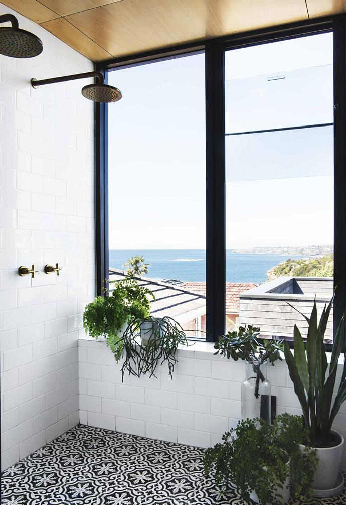 "The contrasting materials extend to the master bedroom situated at the building's summit. Enveloped in Colorbond steel outside and on the roof, plywood sheets are curved around the walls within, making for a boat-like effect inside.<br><br>**Ensuite** The wet zone has a picturesque view over Gordons Bay and beyond. The showers and taps are from [Astra Walker](http://www.astrawalker.com.au/|target=""_Blank""