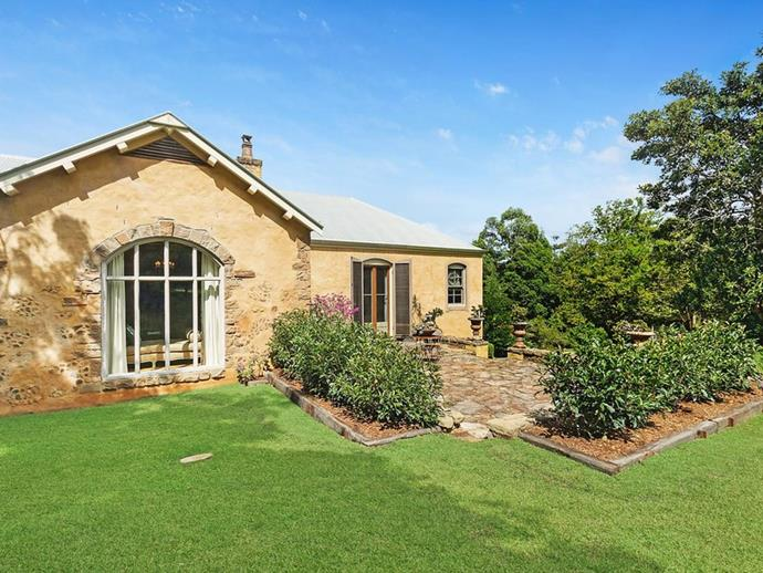 "A stone courtyard. *Photo: [McGrath](https://www.mcgrath.com.au/buy/house/nsw/northern-rivers/dalwood/393492|target=""_blank""