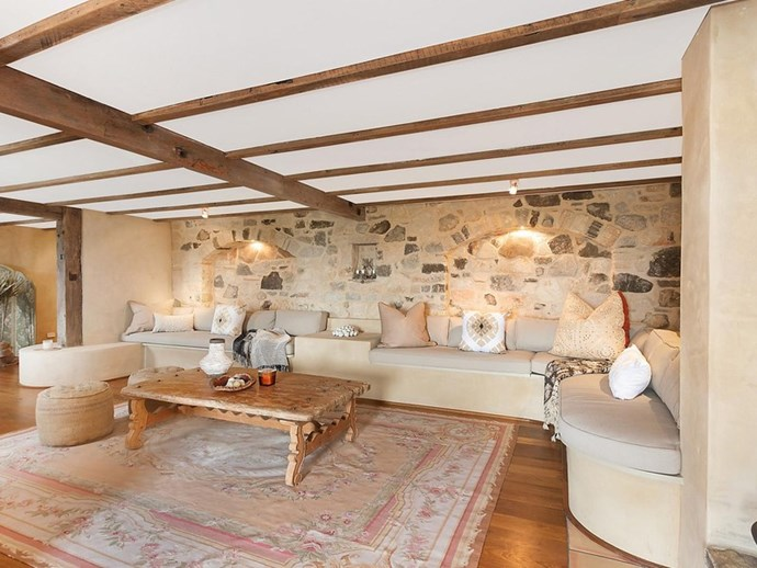 """A second formal living space in the guest quarters features bench seating and an exposed stone wall. *Photo: [McGrath](https://www.mcgrath.com.au/buy/house/nsw/northern-rivers/dalwood/393492