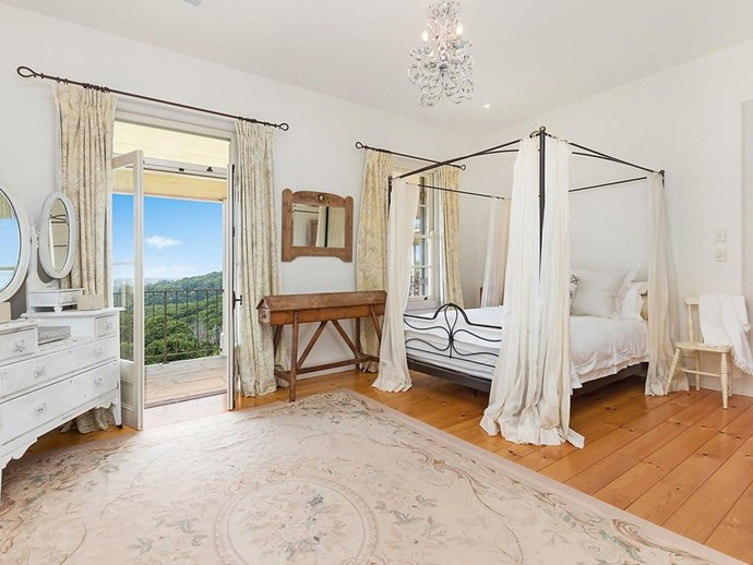 """A bedroom with sweeping bushland views. *Photo: [McGrath](https://www.mcgrath.com.au/buy/house/nsw/northern-rivers/dalwood/393492
