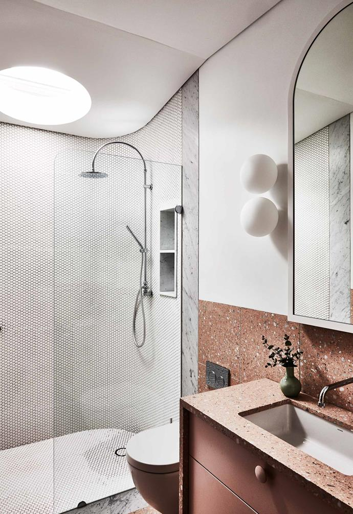 **Material mix** A mixed palette of materials create a luxurious space in this bathroom space with rich terracotta terrazzo tiles paired with white penny rounds and a marble trim. *Photography: Kristina Soljo / bauersyndication.com.au*