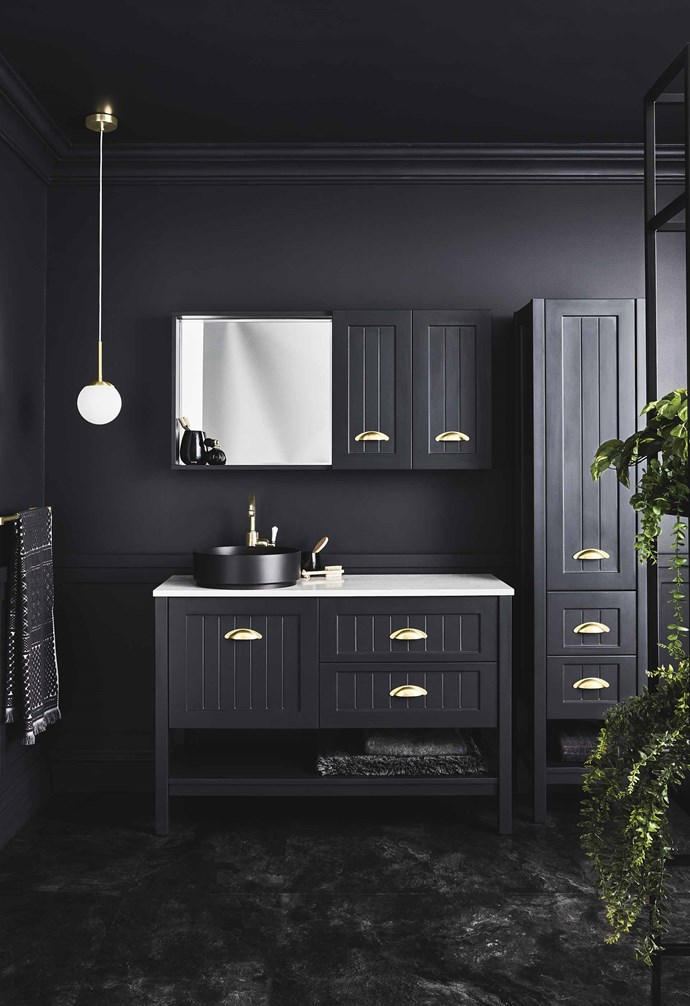 **Black is back** With a nod to traditional Shaker style, Reece's 'Kado Era' range has a vanity unit with gold-brass handles and a stone top plus shaving and linen cabinets, all in Dulux Domino. *Photography: Maree Homer*.