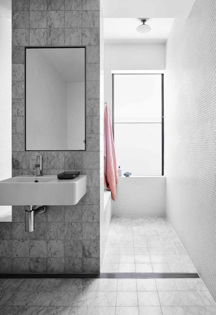 """**Boys' bathroom** Fitted out with 150mm Carrara marble squares from [Bisanna Tiles](https://www.bisanna.com.au/