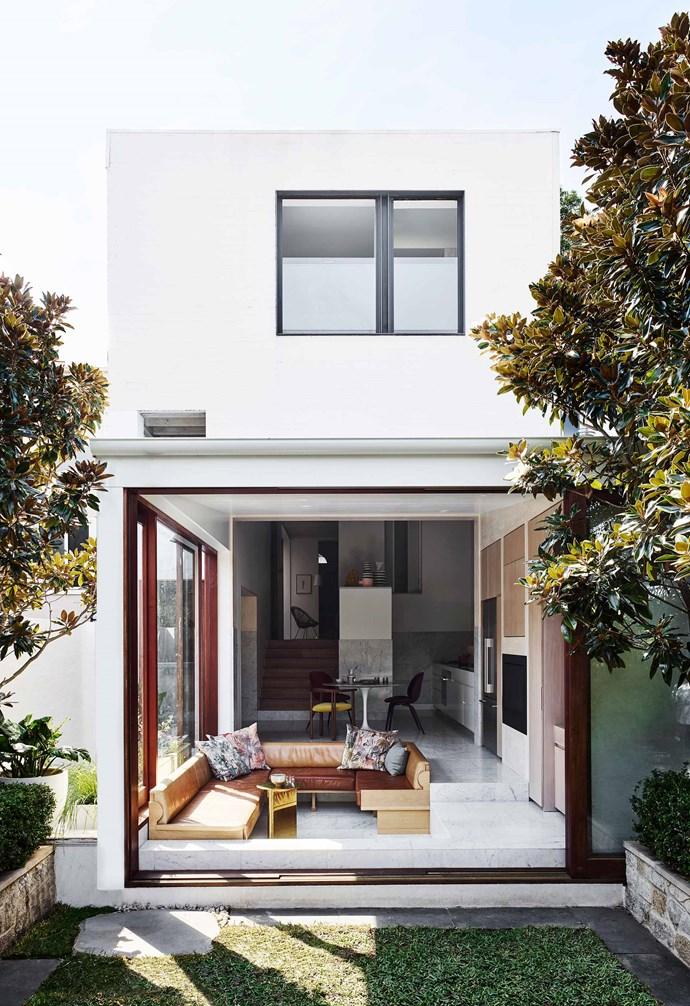 **Rear** When the Merbau doors are slid to one side, the back and side of the house are completely open. The ceiling height above the sunken lounge is 3.2m (on a slight angle) and it reaches 4.5m in the kitchen.