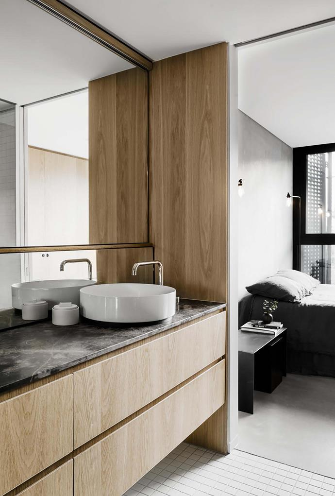 The bathrooms feature timber joinery with natural stone surfaces.