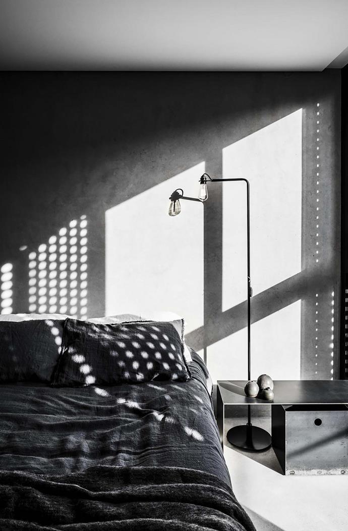 In the bedroom, Topos 'Line' floor lamp.