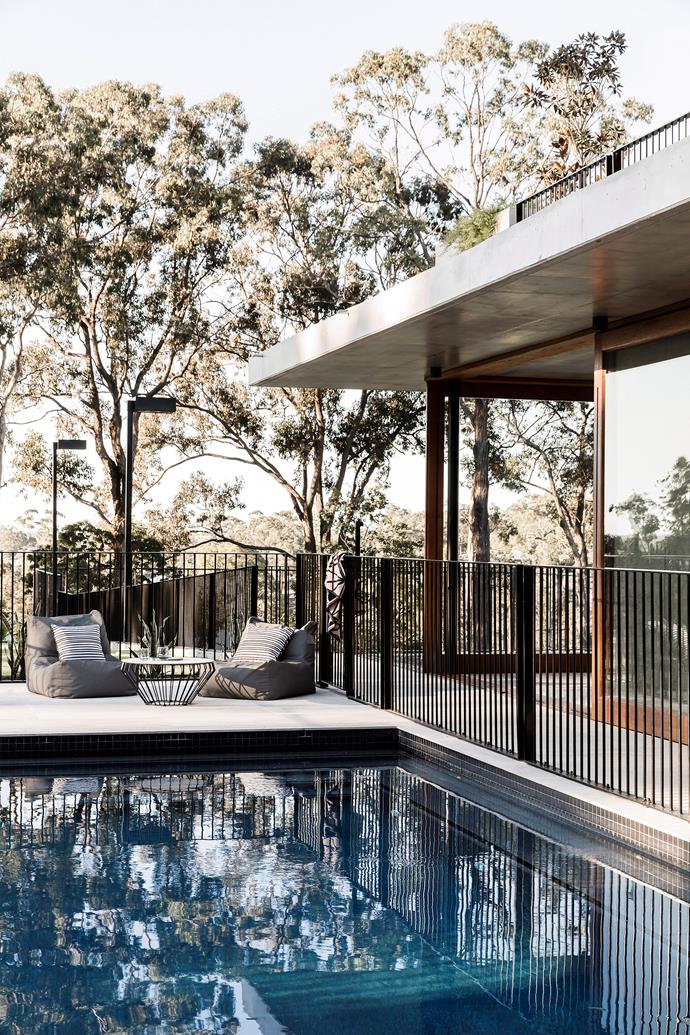 A dark pool fence blends in seamlessly with the surrounding landscape. *Photo:* Maree Homer / *bauersyndication.com.au*