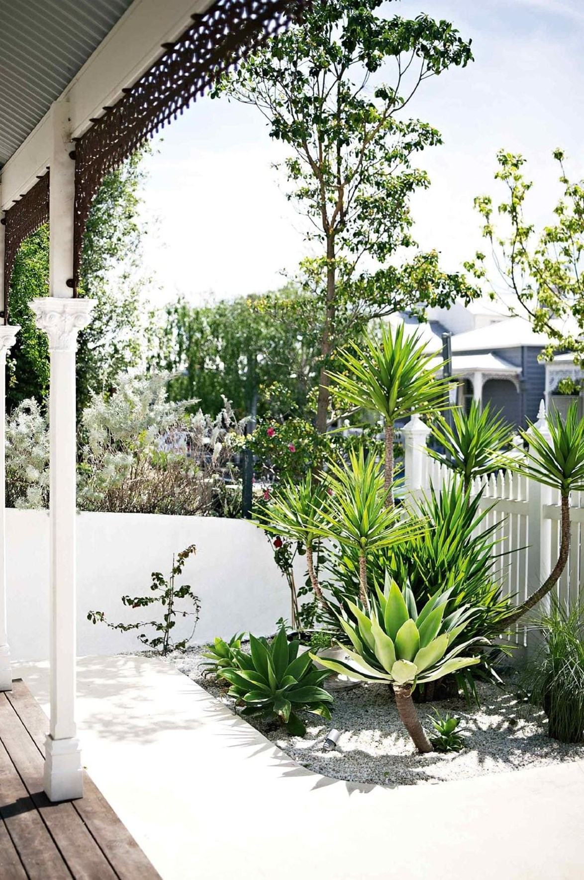 "Create a home that turns heads by transforming your [front garden](https://www.homestolove.com.au/front-garden-inspiration-17367|target=""_blank"") to boost the kerb appeal of your home. This simple garden has been created using sculptural, low-maintenance plants and white pebbles."
