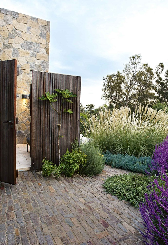 """A pathway of steppers is a relaxed treatment where a solid path isn't necessary. These steppers are mini pieces of the main paved area, formed in situ repeating the stone paving. *Design: [Michael Cooke Garden Design](https://www.michaelcooke.com.au/