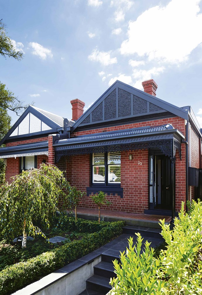 """Trimmed hedges and young trees create a traditional and formal look in the front garden of this [renovated Edwardian house](https://www.homestolove.com.au/modern-edwardian-semi-renovation-18524