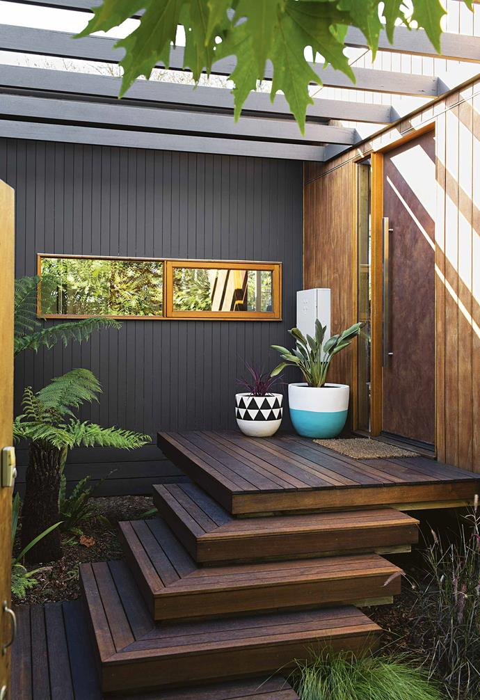 "This [timber-clad sustainable home](https://www.homestolove.com.au/timber-clad-sustainable-house-17545|target=""_blank"") features a lush entry garden that boasts hardy plants and shrubs that will grow along the stairs. *Design: [Maxa Design](https://www.maxadesign.com.au/