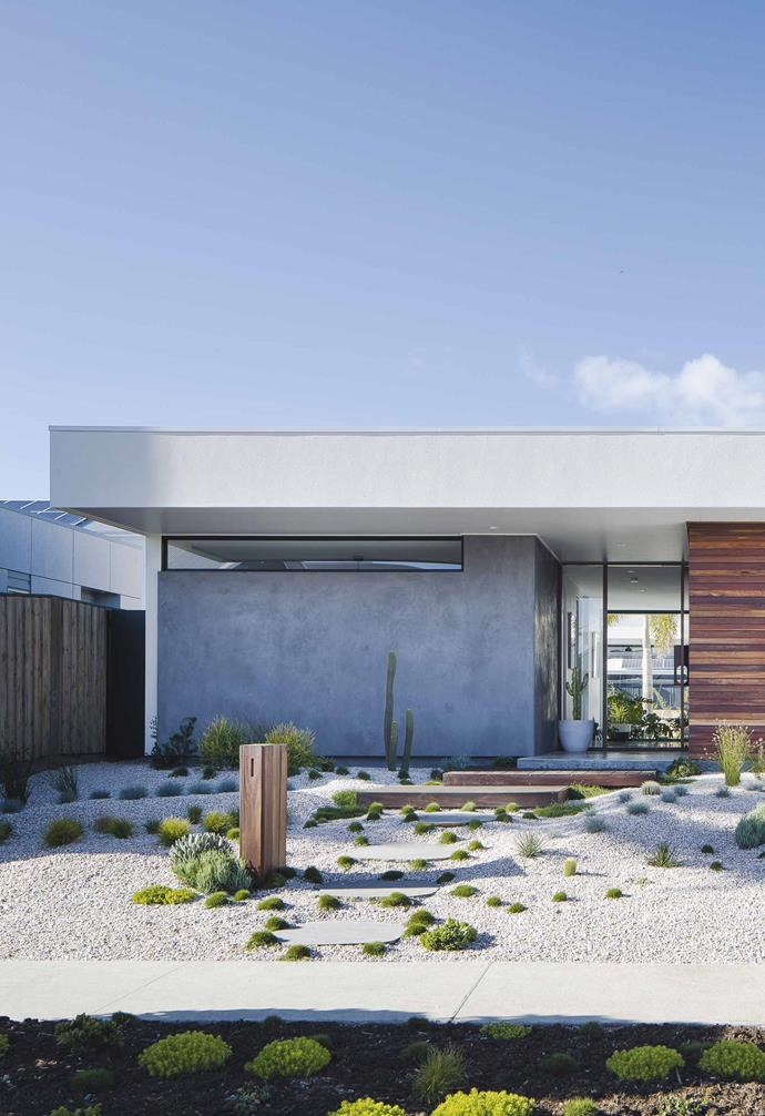"In keeping with the Palm Springs-inspired aesthetic of this [Casuarina home](https://www.homestolove.com.au/palm-springs-inspired-home-19646|target=""_blank"") the front garden features sculptural cactii and succulents whose low profile allows the facade of the home to stand as the hero. *Design: [Create Architecture](http://createarchitecture.com.au/