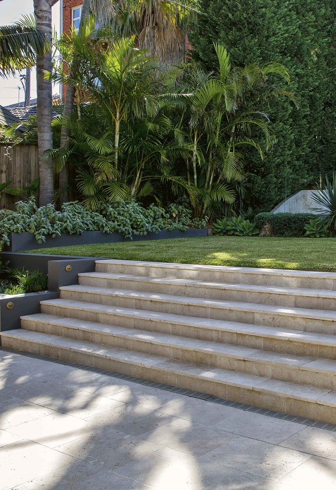"""The pool, meanwhile, was a renovation job in itself. """"It was 40 or 50 years old and lined with pebblecrete, which extended up to become a curved wall dividing the garden from a unit block behind,"""" says Matt. """"So we squared up the wall, clad it in limestone and then retiled the pool.""""<br><br>The pool was surrounded by [decking](https://www.homestolove.com.au/balcony-and-deck-design-ideas-2458