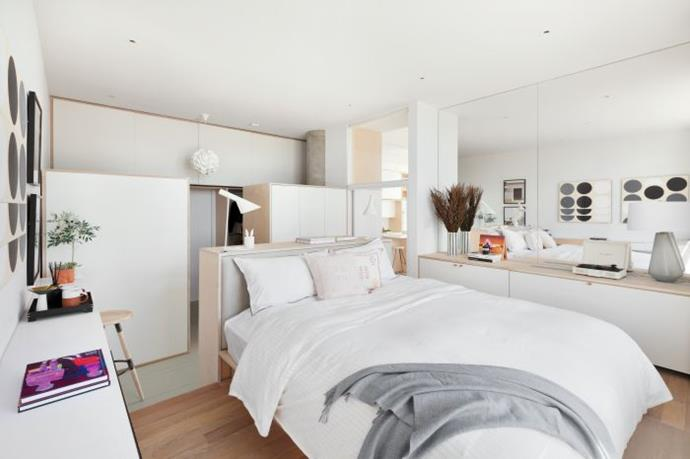 "The master bedroom centres around a raised platform bed, while a walk-in closet and a luxurious ensuite can be found behind the nib wall. *Photo:* [DDreps](http://ddreps.com/|target=""_blank""